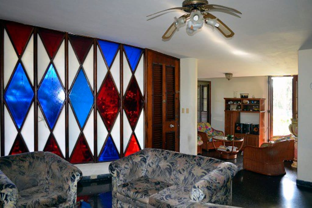 View of the living room with vitrals of different color.