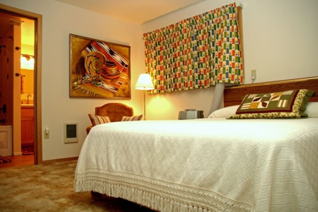 Room 5 located on the upper floor with 1 Queen Bed