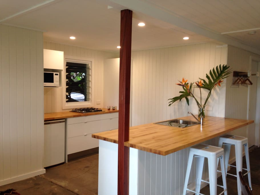 Solid timber kitchen breakfast bar looking into kitchen