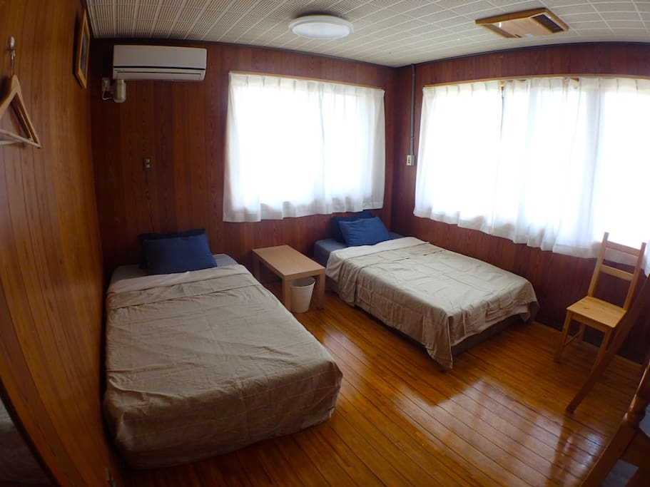 room has two single beds and a bunk bed.extra futon is available if you are group of five.
