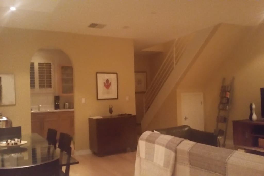 """Living /dining room area with 42"""" flats center TV, cable service, and excellent high speed wi-fi service."""
