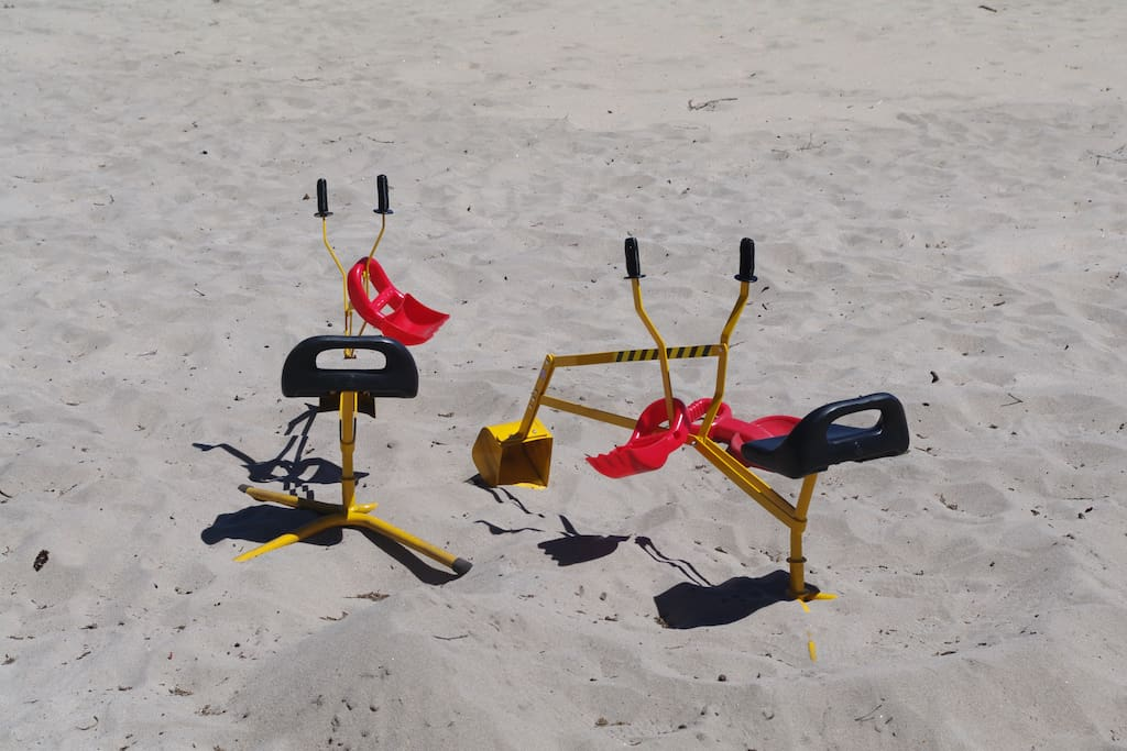 Beach toys, sand diggers, swing set/slide etc.,
