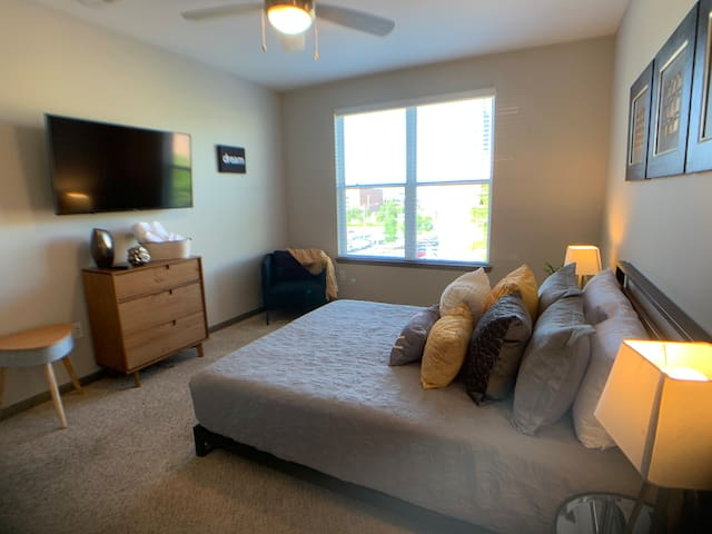 Bedroom with 50 inch Smart TV for Streaming Netflix, Prime, Hulu and other Apps.