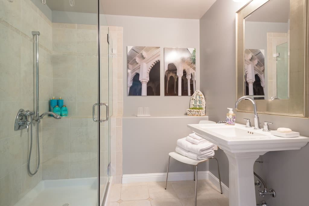 Bathroom with all amenities - including hair drier, plush robes, shampoo, body lotion, and every day essentials