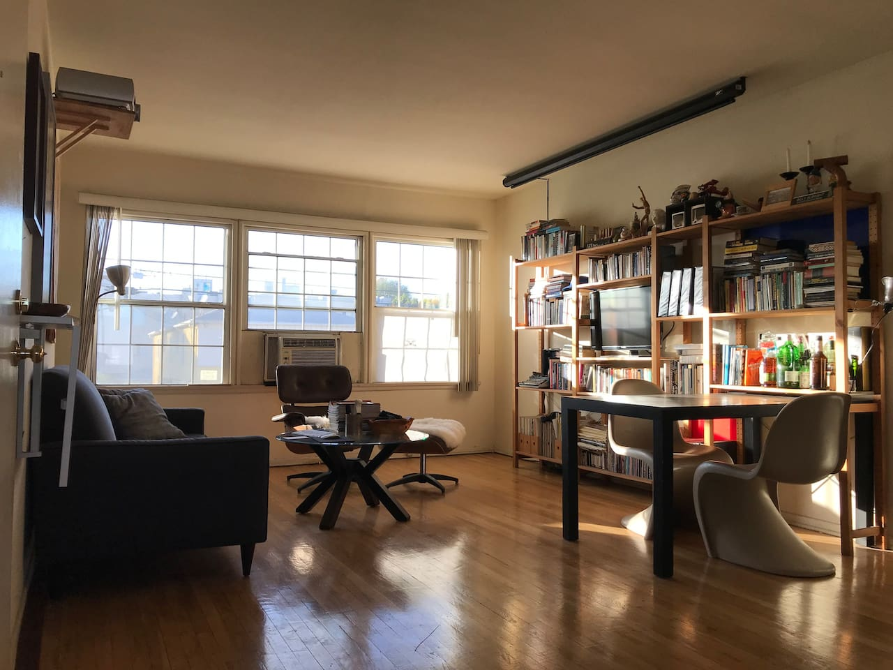 Bright, sunny living room with projector screen (raised)