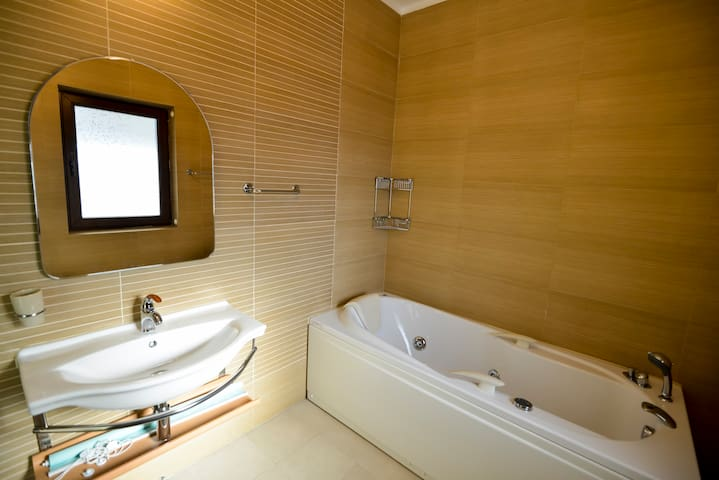 Bath with jacuzzi-first bedroom