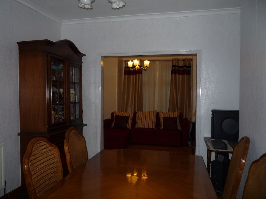 Dining room, with the lounge/sitting room visible at back