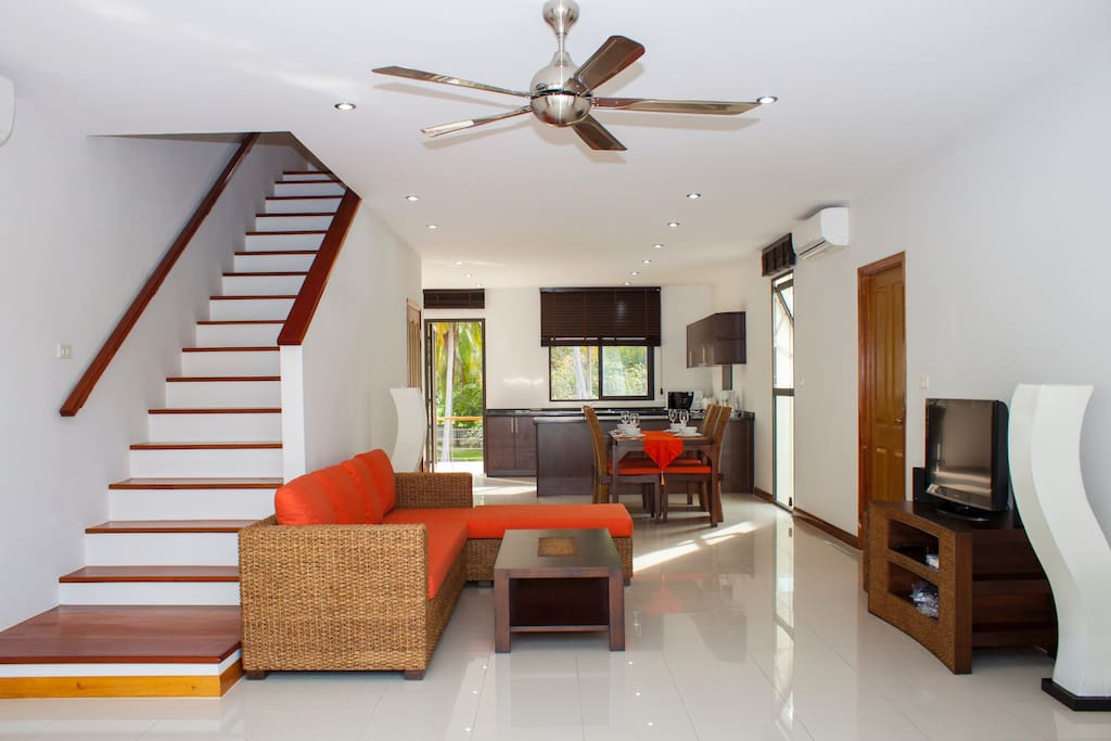 The spacious open plan lounge,diner,kitchen with flat screen satellite tv and balcony each end.