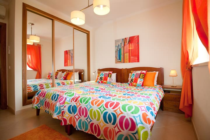 Orange Bedroom, beds can be single or double if joined together.