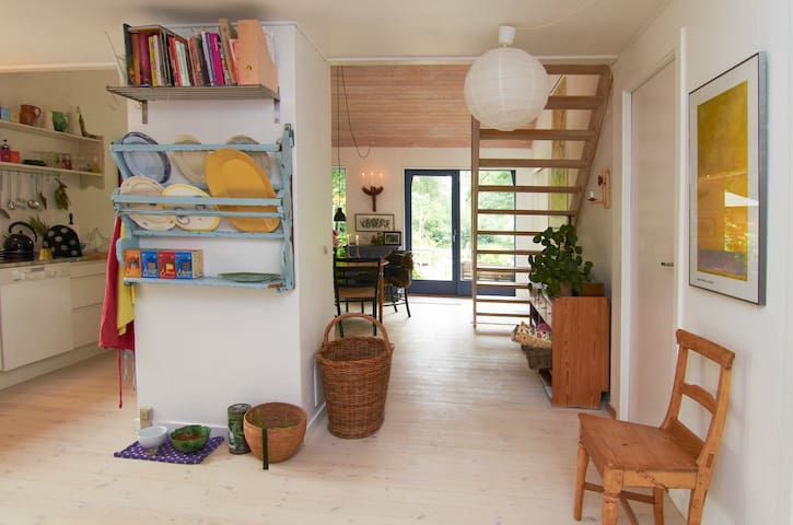 Entering living area, kitchen to the left, living room behind chimney
