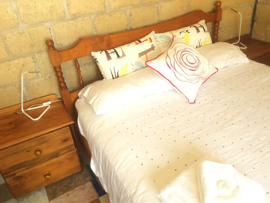 fresh white bed linen on queen sized bed