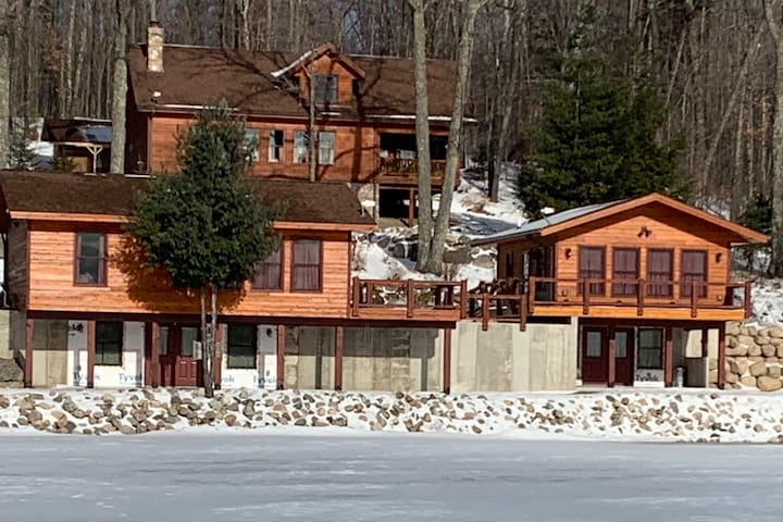 Piacenza Cabins. Due, the two-bedroom is on the left; Uno, the studio on the right; our cabin is across the street on the hill.  You can rent either of the lakeside cabins of both.  We have 3 listings on Airbnb to accommodate your use.