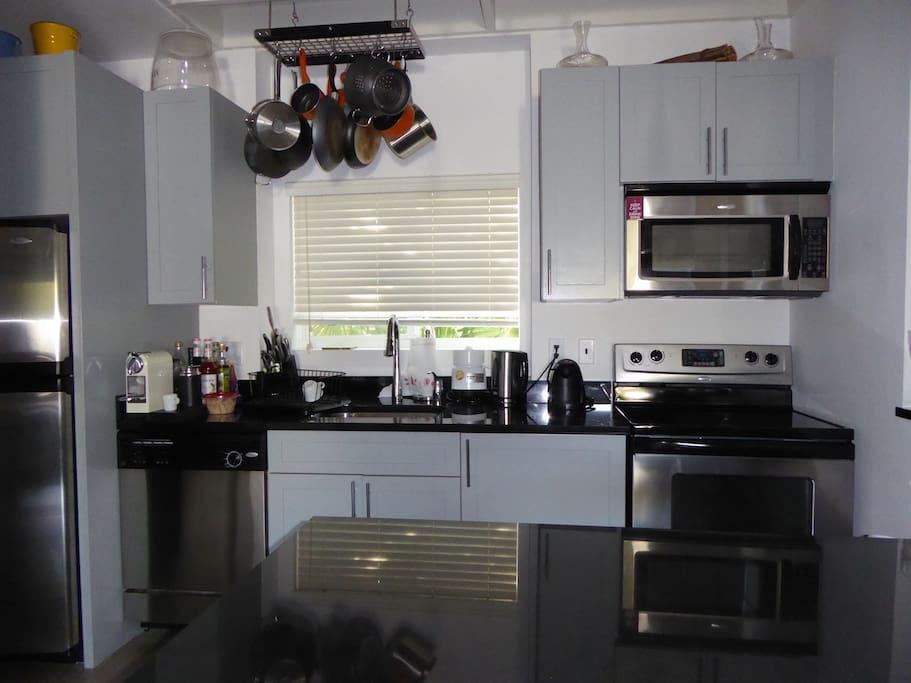 Full kitchen, large fridge, granite tops, wine fridge