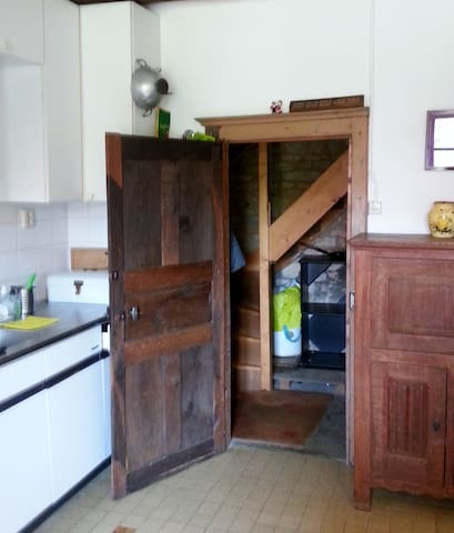 Kitchendoor with acces to the stairs direction extra room upstairs