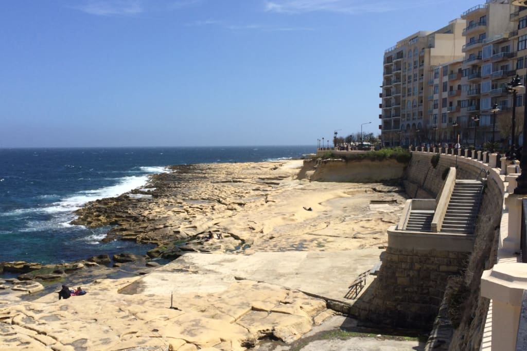 Rocky beach opposite the apartment leading towards Sliema.