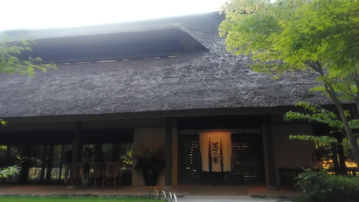 Cafe with huge straw roof  to take photo