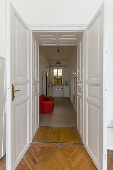 Huge hallway leading up to the living room