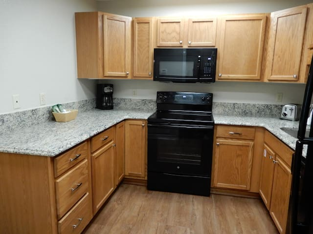 Full kitchen that includes a microwave, full stove and oven, blender, coffee maker, toaster as well as a full fridge. 9/13/19