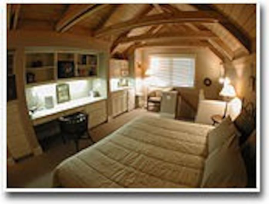 Room 8 - the lofted aerie:  overlooks our gardens and lawns