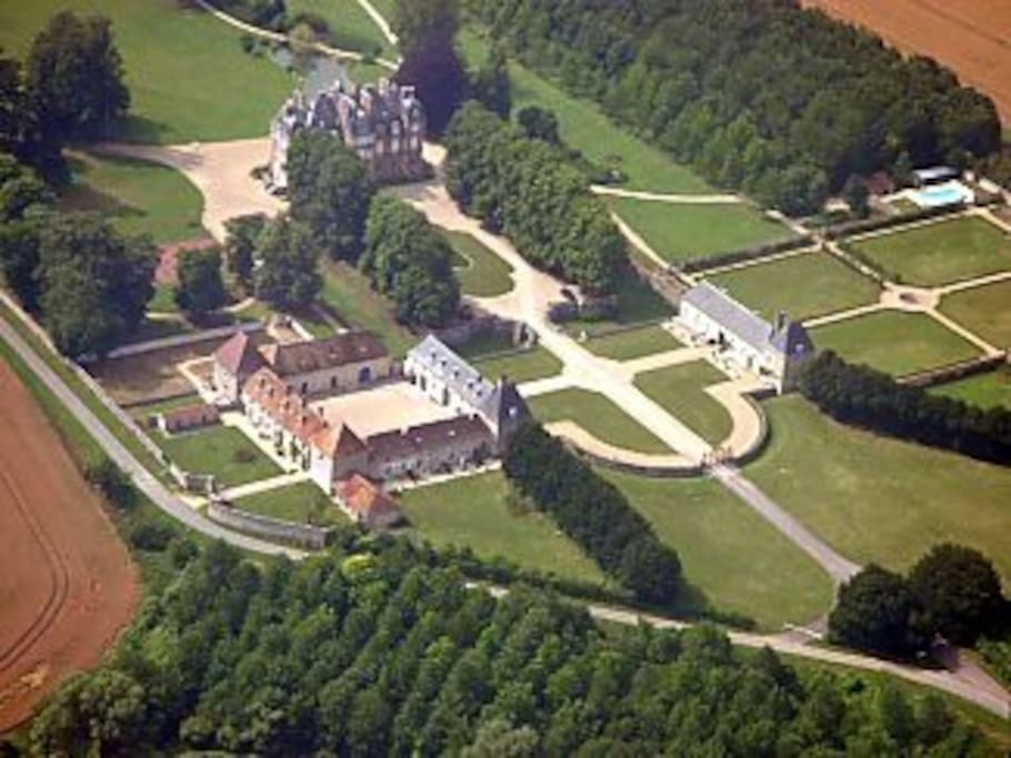 Aerial view of Chateau de la Trousse. The Orangery is on the right. Pool top right.