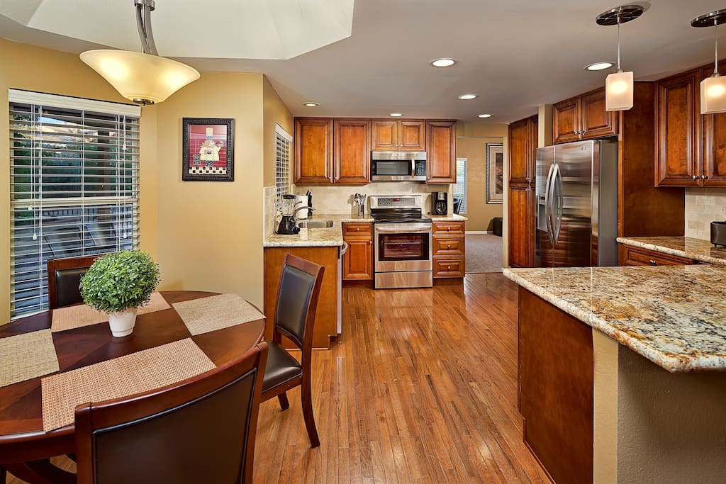 Beautiful kitchen with granite counter tops, new appliances, and cooking/dining utensils!