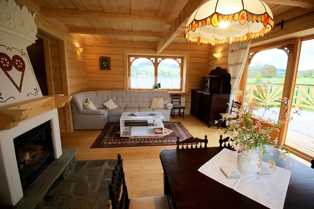 The main living room with dining area, with space for 12 people (table can open bigger) with cozy fireplace