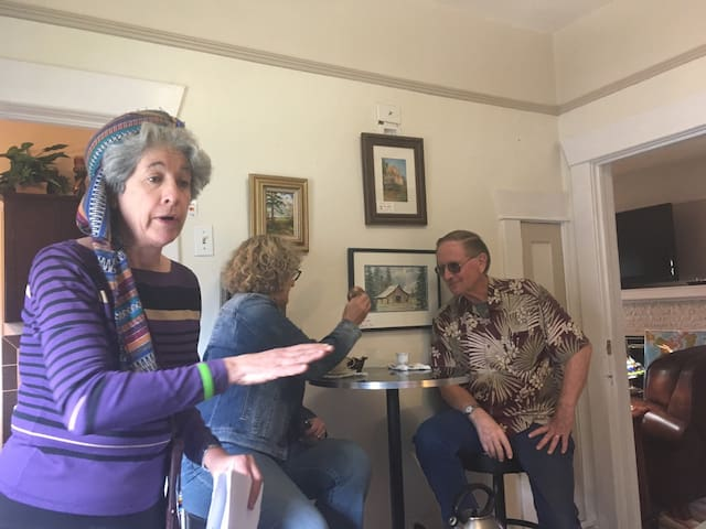 Elaine joining her guests over a cup of coffee (Turkish method of preparation -- note the demitasse cup)