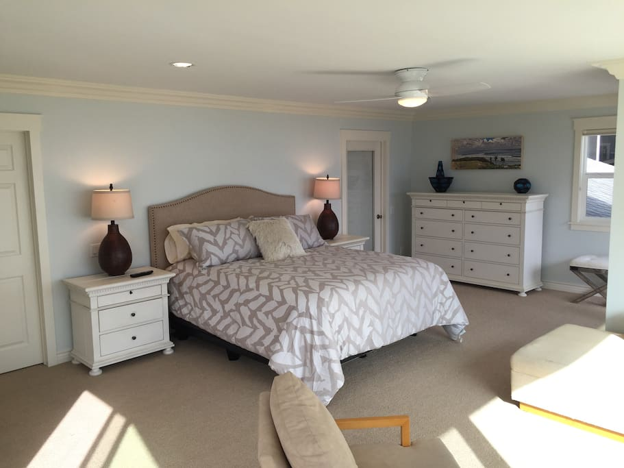 Luxurious master bedroom with Cal King bed and whitewater ocean view.