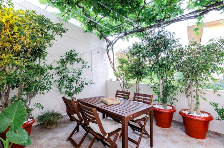 Relax under the arbor and enjoy its shade.