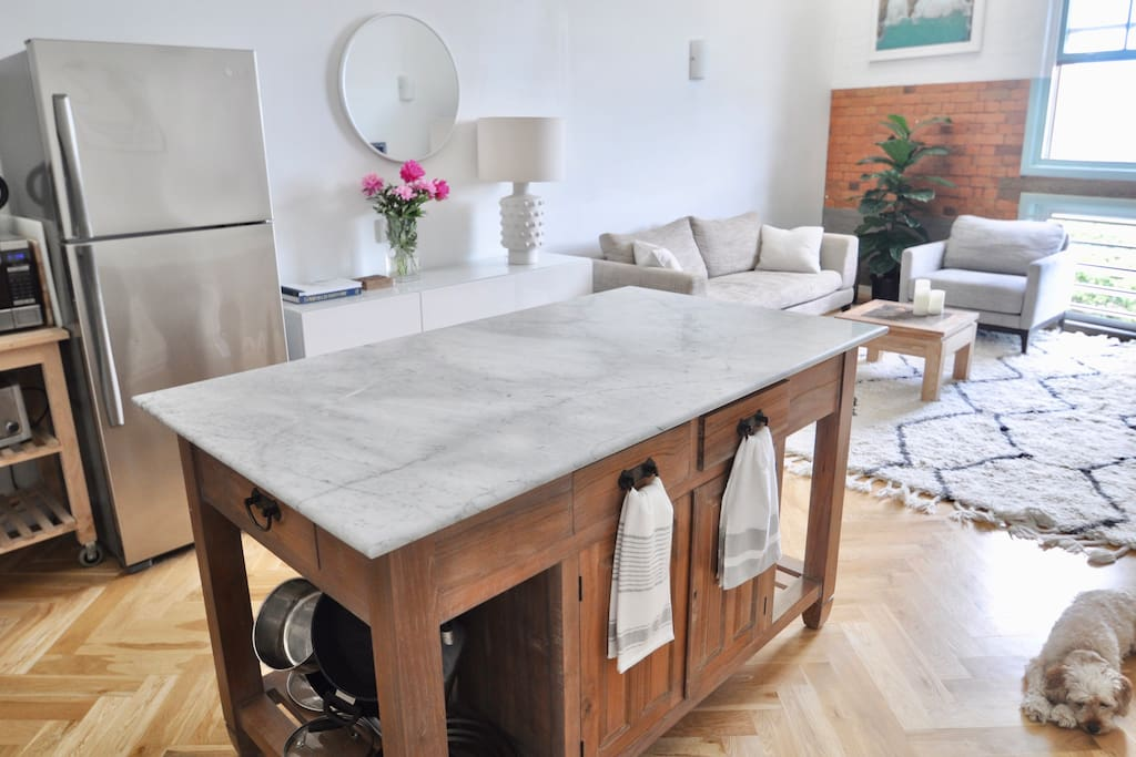 Island bench with marble countertop is the perfect spot for your morning coffee