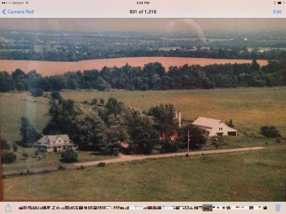 Ariel view of farm showing farmhouse  on the left  and big barn with  loft  on the right. Highway K-68 is in front of the house.