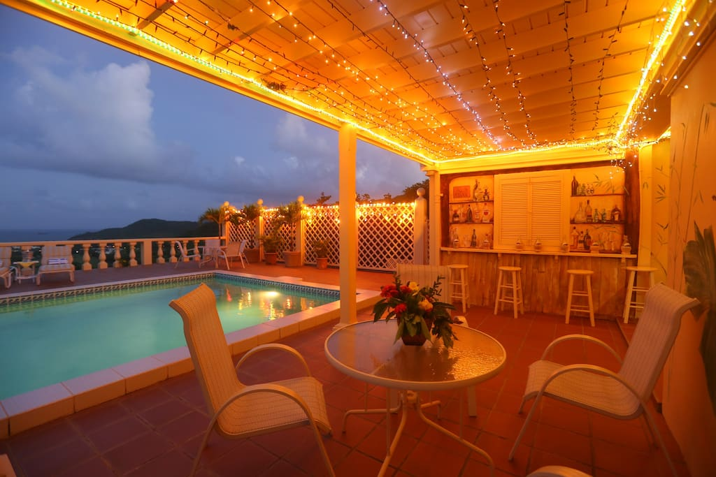 pool area at night relax and enjoy a glass of wine. We want our guests to have a memorable vacation