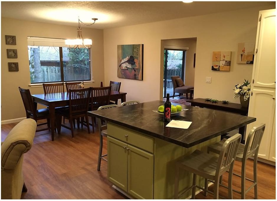 The open floor plan of the kitchen, dining, and living areas welcome you home.