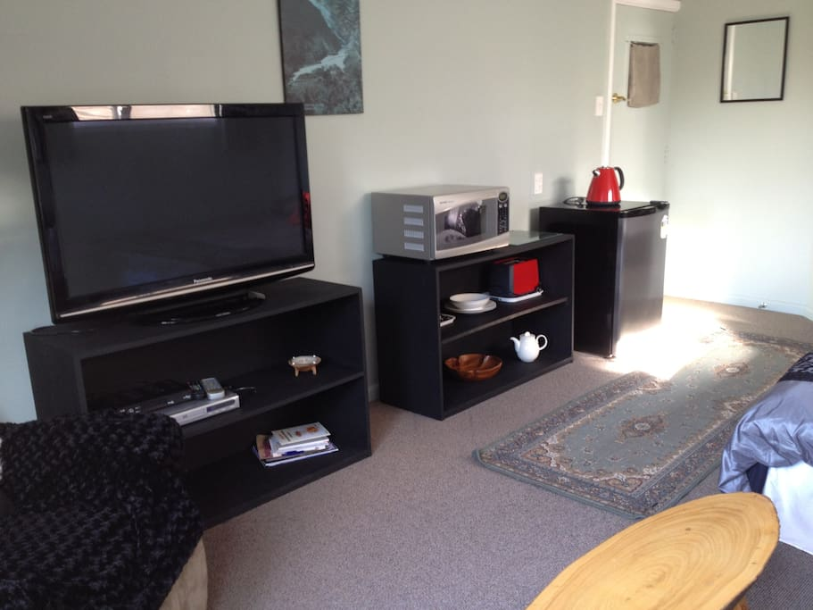 45 inch HD TV, freeview satellite TV and DVD player.