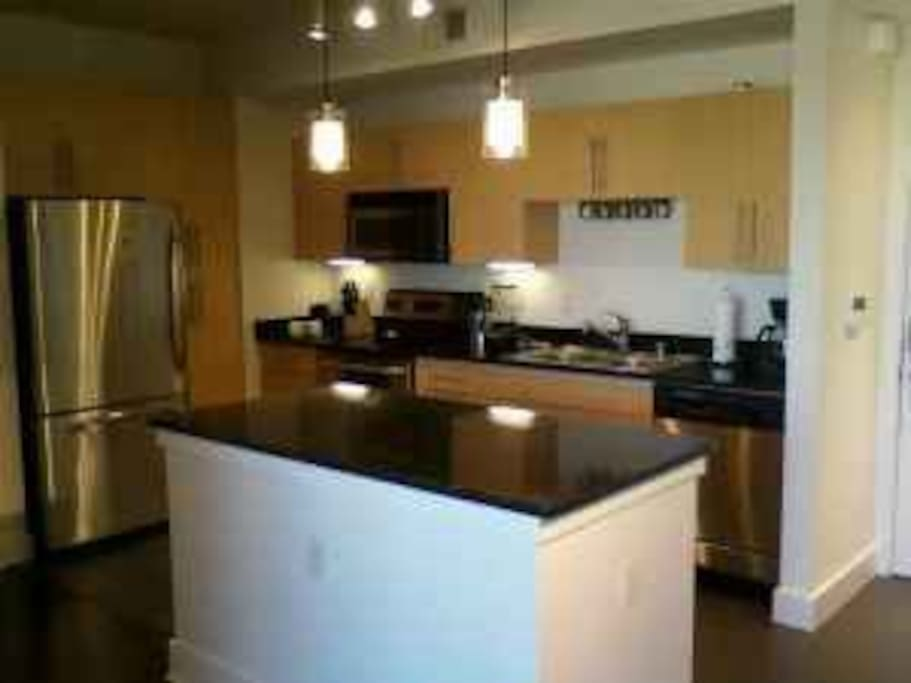 Stainless steel appliances, granite counter top, recessed lighting