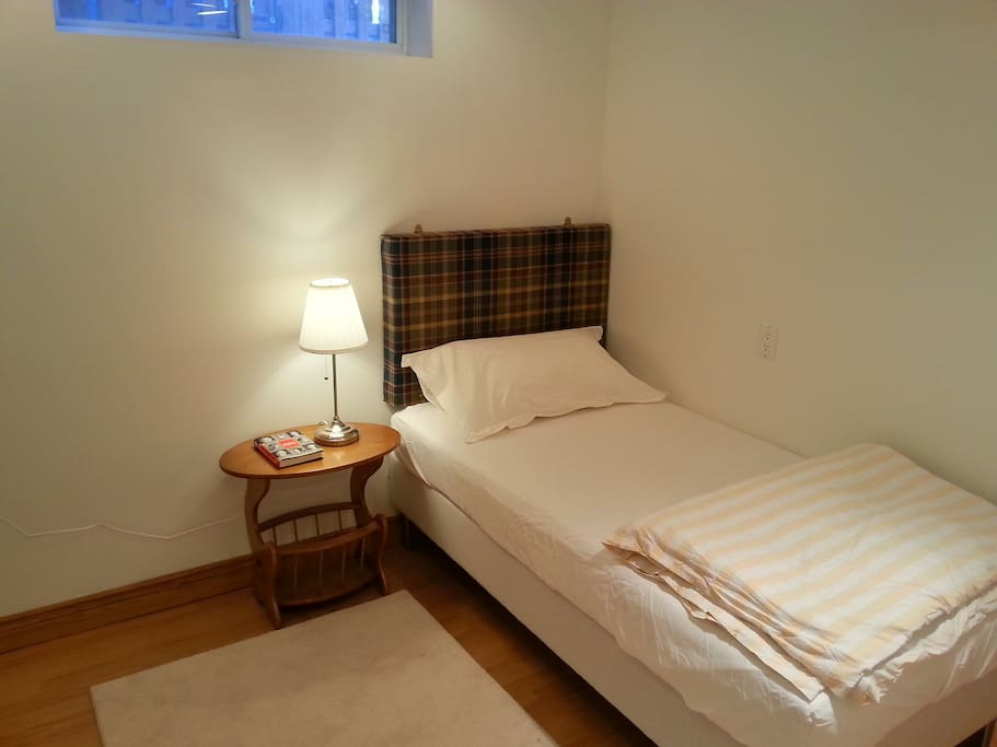 The single bed is a generous 90cm wide. There is a soft rug on the floor.