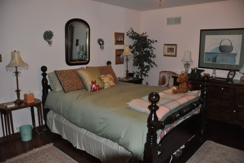 Larger of two rooms with queen bed and single (day) bed