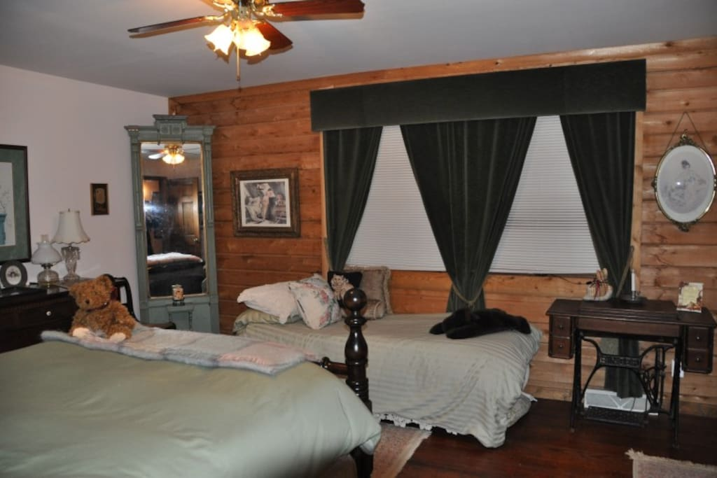 Larger of two bedrooms with queen and single bed