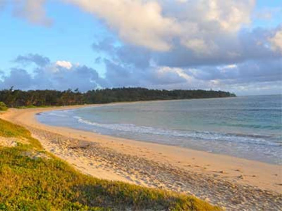 Hukilau Beach, relax on the white sand just outside your cottage.