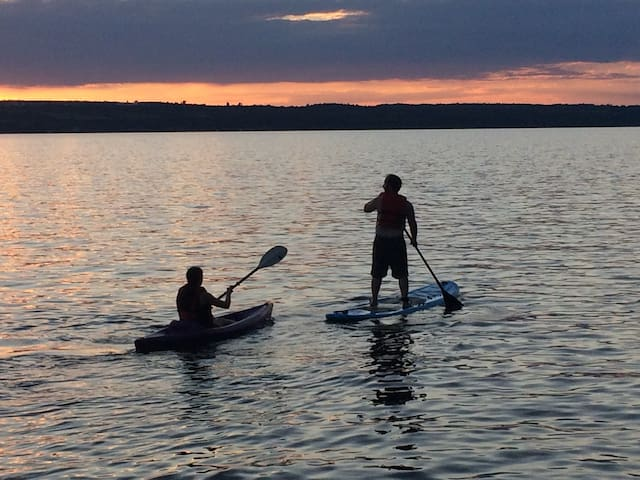 5 Kayaks and 2 Stand up paddle boards to use dawn to dusk.