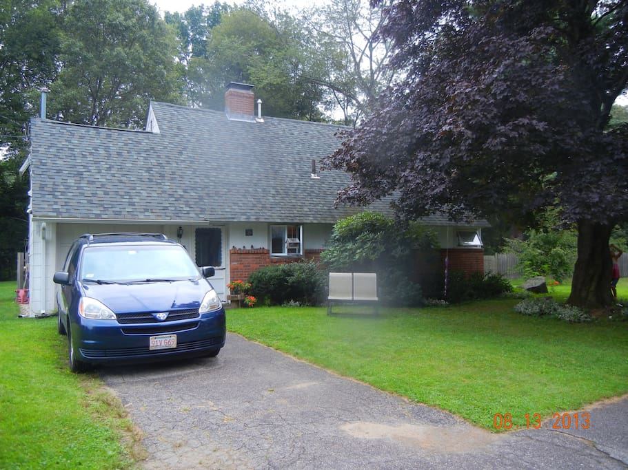 Front view, driveway holds 2 cars, plenty of additional street parking, nice shade tree