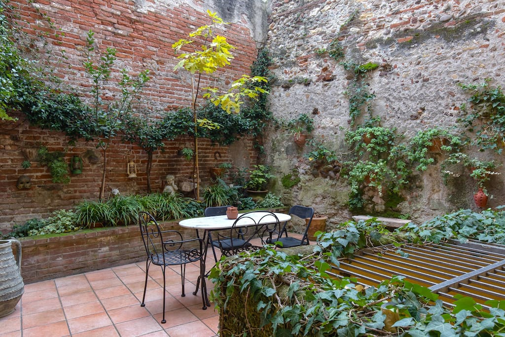 Private garden terrace with table