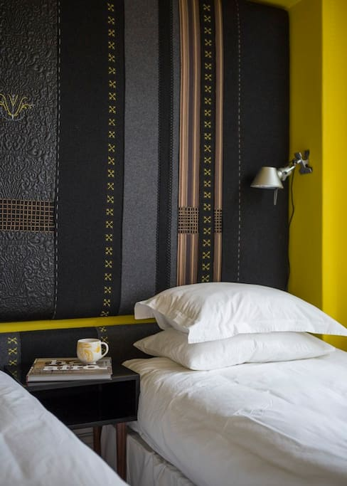 Twin beds or one King-sized bed make the Yellow Room versatile and adaptable