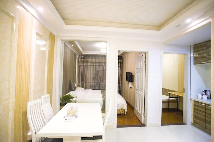 大连金州区悦庭酒店式公寓豪华海景套房 - Dalian - Servicelägenhet