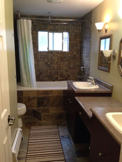 Large spacious bathroom with double sink and soaker tub
