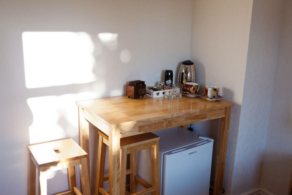 Breakfast table with tea/coffee facilities and mini fridge for your convenience