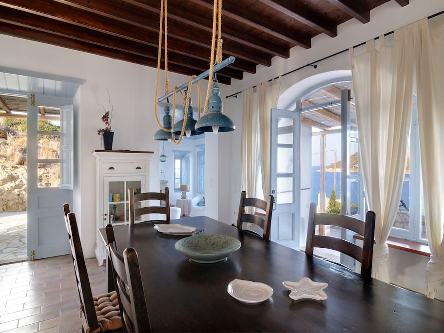 The dining area that enjoys access to a liveky private terrace overlooking the sea
