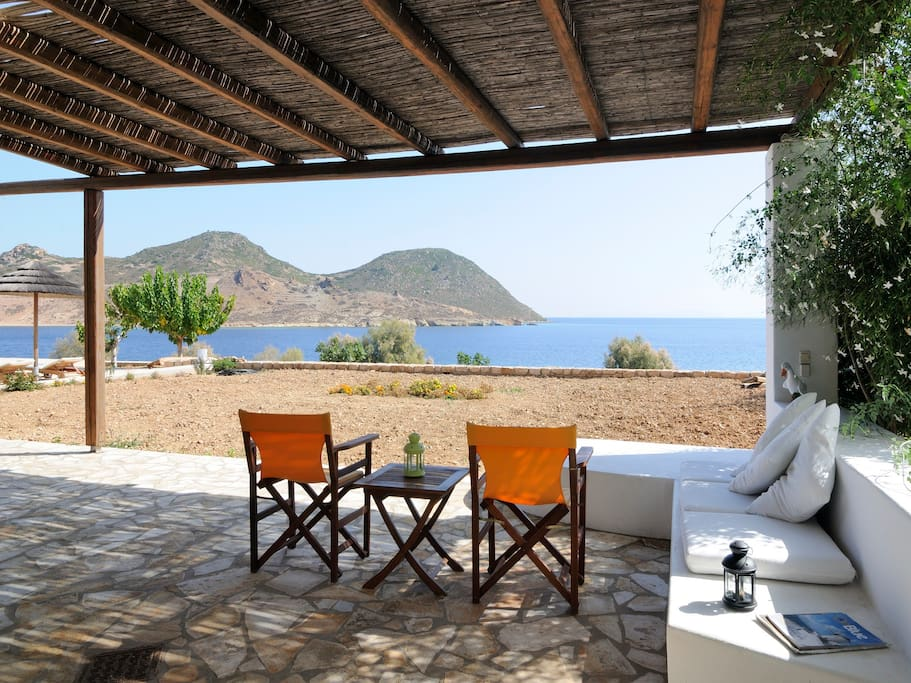 Private patio with lovely sea views. The swimming pool is towards the left hand side