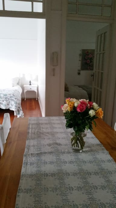 View from open plan dining table into bedrooms