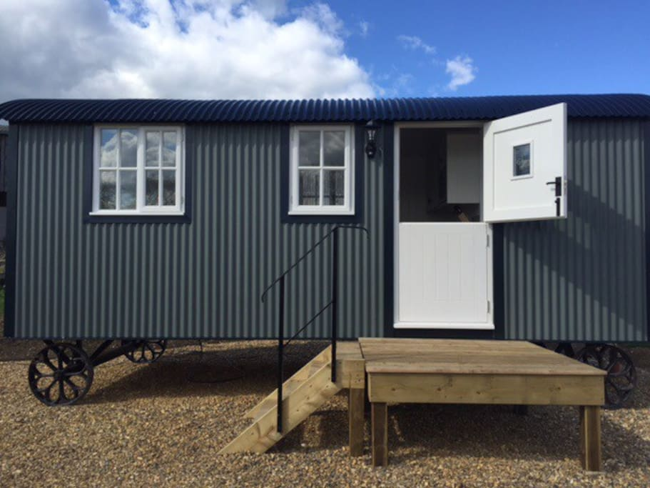 Our wonderful shepherds hut set in its own grounds with only the birds, lambs and calves for company!  Situated within its own garden with a patio set so you can watch the sun go down with just the birds to listen to.